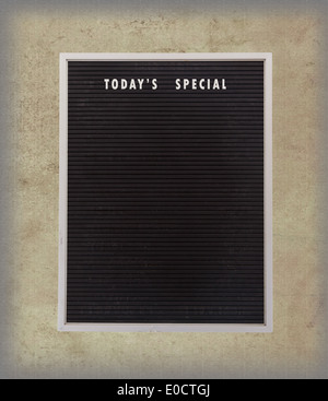 Empty restaurant board stand (people stopper) with today's special isolated on vintage background - Stock Image