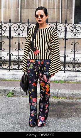 A chic showgoer attending the Dries Van Noten runway show during Paris Fashion Week in Paris - Feb 26, 2014 - Runway Manhattan/Celine Gaille - Stock Image