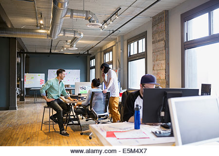 Creative business people working in office - Stock Image