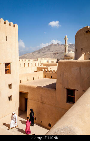 Omani Tourists At The Nizwa Fort, Nizwa, Ad Dakhiliyah Region, Oman - Stock Image