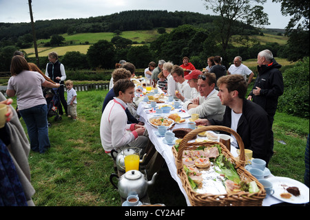 Cricket tea at the annual match between Arden Hall visitors and The Sun inn ( spout House ) team. - Stock Image
