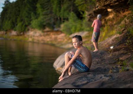 Two teenage boys on lakeside, Lake Superior, Au Train, Michigan, USA - Stock Image