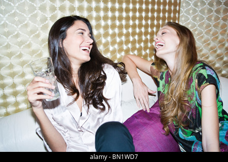 Friends laughing together - Stock Image