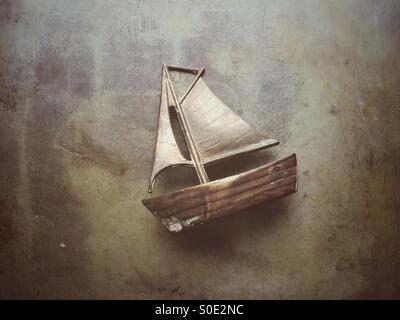 Old metal sailing boat model - Stock Image
