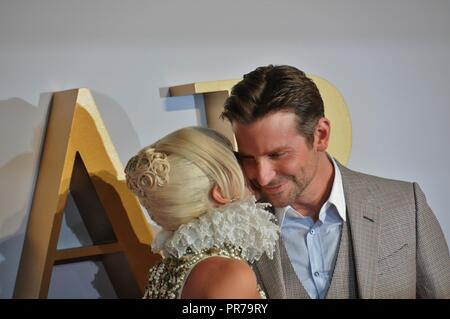 Lady Gaga kisses Bradley Cooper, at the London film premier of A Star is Born. - Stock Image