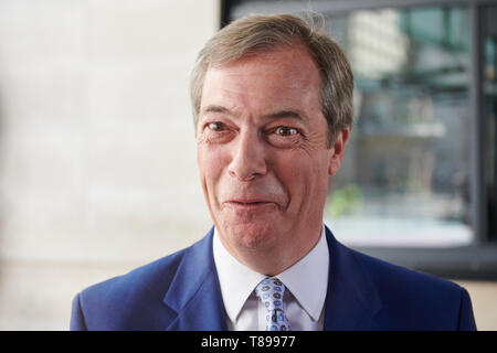 London, UK. 12th May 2019. Nigel Farage, leader of the Brexit Party, leaves the BBC Broadcasting House, after his appearance on the Andrew Marr Show . Credit: Thomas Bowles/Alamy Live News - Stock Image