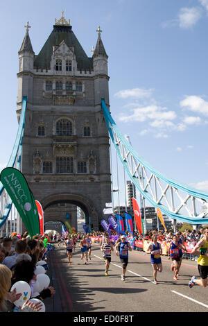 LONDON - APRIL 13: Unidentified men run the London marathon on April 13, 2014 in London, England, UK. The marathon - Stock Image