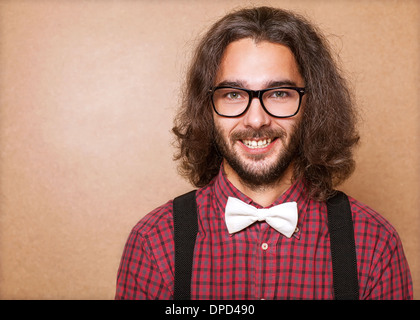 Hipster guy 's clothes in plaid shirt , suspenders and white butterfly . Close up. Studio shot - Stock Image