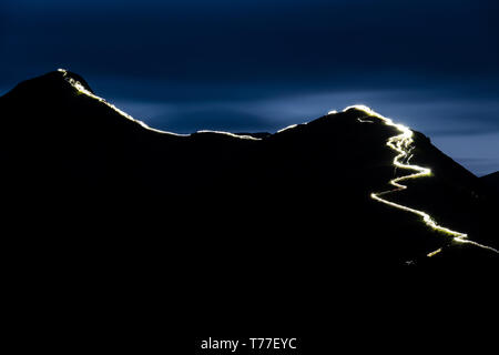 Cumbria, UK. 4th May, 2019. Now in its fifth year, the Lakeland Festival of Light, held in Keswick, Cumbria, UK on Saturday, May 4, 2019 saw hundreds of people line the spine of Catbells mountain in the Lake District with head torches at night, lighting up the path to the summit, all for charity. The chosen charity this year was the Lake District Mountain Rescue Search Dogs. Credit: Christopher Middleton/Alamy Live News - Stock Image