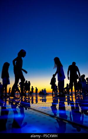 People silhouette on colorful sunset, Zadar, Croatia - Stock Image