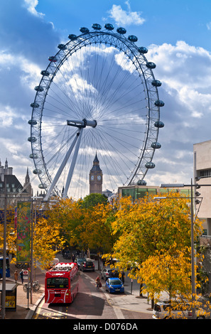 The London Eye on SouthBank and Big Ben, with new hydrogen powered red London bus in foreground and autumnal colour - Stock Image