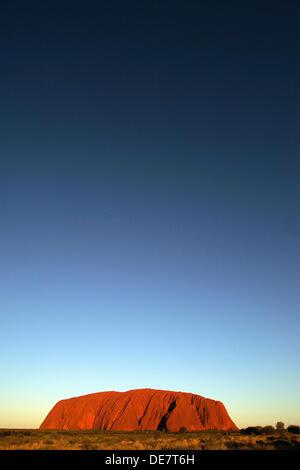 Sunset over Uluru Ayres Rock in Northern Territory in Australia - Stock Image