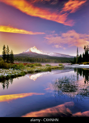 Mount Washington reflection in Big Lake with snow and sunset. Oregon. - Stock Image