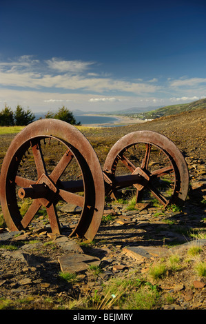 autumn afternoon Old slate mining quarrying equipment lying rusting and abandoned in a quarry above Friog Gwynedd - Stock Image