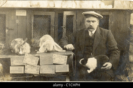 Owner with his prize winning rabbits - Stock Image