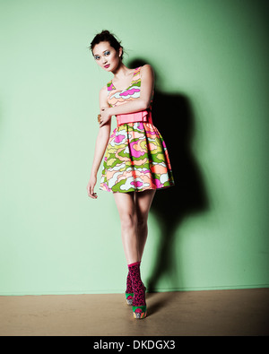 Colorful young lady modeling - Stock Image