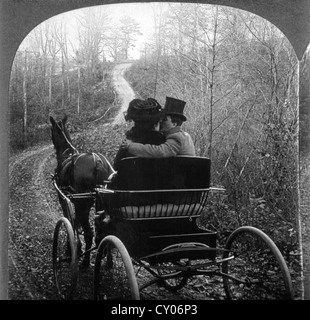 Man and Woman in a Horse Drawn Carriage, Rear View, Stereo Photograph, Circa 1901 - Stock Image