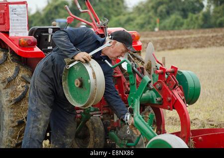 David Chappell making adjustments at British National Ploughing Championships 2014 - Stock Image