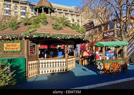 Edinburgh 2014 Christmas Market in Princes Street Gardens Edinburgh Scotland with market stall selling German Bratwurst - Stock Image