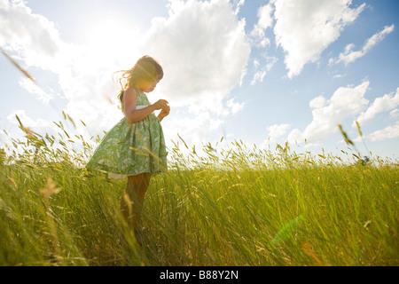 Girl in a Grassy Field in North Dakota - Stock Image