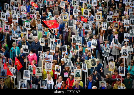 Vladivostok, Russia. 09th May, 2019. VLADIVOSTOK, RUSSIA - MAY 9, 2019: People hold portraits of their relatives who fought in World War II during an Immortal Regiment march on the day of the 74th anniversary of the victory over Nazi Germany in the Great Patriotic War of 1941-1945, the Eastern Front of the Second World War. Yuri Smityuk/TASS Credit: ITAR-TASS News Agency/Alamy Live News - Stock Image