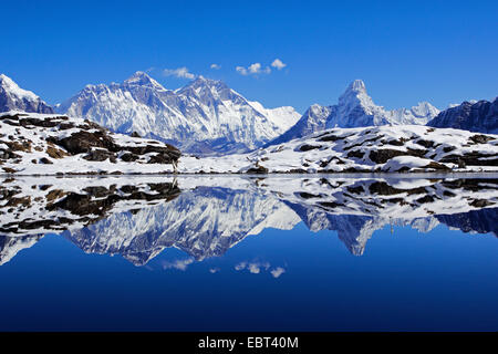 Nuptse, Mount Everest and Ama Dablam mirroring in Lake Kongde, Nepal, Khumbu Himal - Stock Image