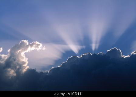 Sun rays through clouds - Stock Image