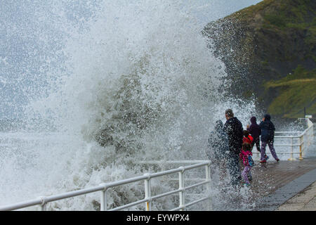 Aberystwyth, Wales, UK. 4 August 2015. Stormy Weather.  A 5-8 ft swell, high winds and a high tide cmbine to lash - Stock Image