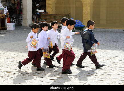 School children wearing school uniforms, Doha, Qatar, Arabian Peninsula, Persian Gulf, Middle East, Asia - Stock Image