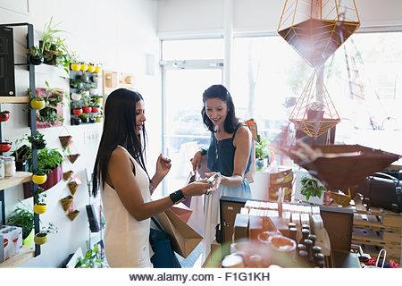 Women shopping in housewares shop - Stock Image