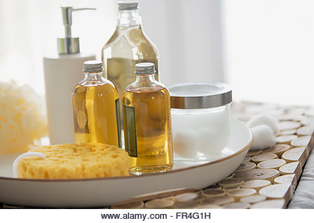 Still of bathroom lotions, soap and cottonballs. - Stock Image