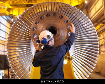 Engineer Inspecting Turbine - Stock Image