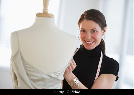 USA, New Jersey, Jersey City, Portrait of young fashion designer at work - Stock Image