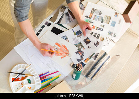 Fashion designer drawing sketch - Stock Image