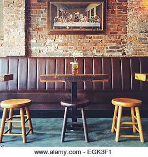 Pub table and stools with The Last Supper in background - Stock Image
