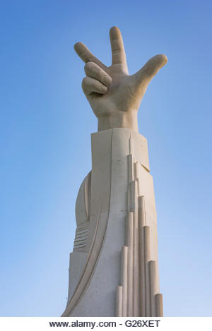 The three-finger salute was introduced by His Highness Sheikh Mohammed bin Rashid Al Maktoum in February 2013 - Stock Image