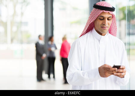 modern Islamic businessman using smart phone - Stock Image