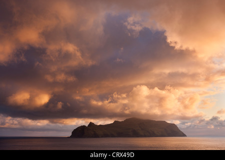 Spectacular sunset skies above the island of Mykines, Faroe Islands. Spring (May) 2012. - Stock Image