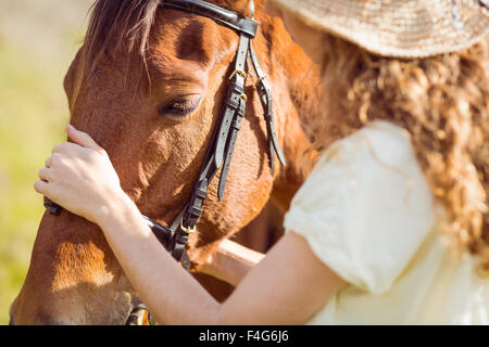 Young woman with her horse - Stock Image