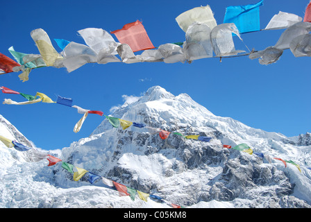 Mount Everest and Prayer Flags - Stock Image