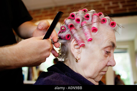 Lady 70s 80s at traditional hairdressers England UK - Stock Image
