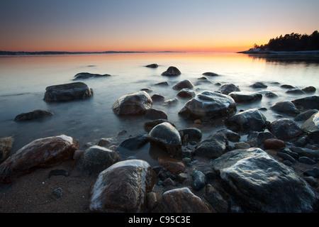 Coastal landscape at dusk at Oven, by the Oslofjord, in Råde kommune, Østfold fylke, Norway. - Stock Image