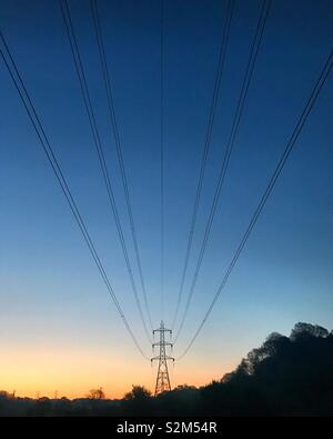 Power lines against a sunrise in Manchester, England - Stock Image