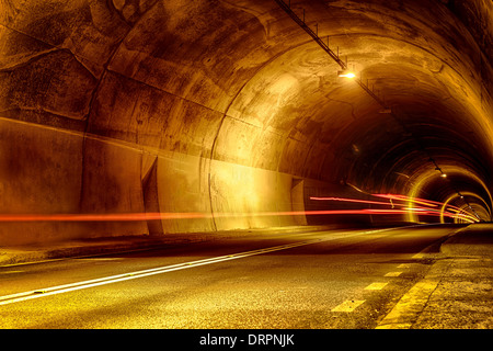 tunnel at night with traces of light - Stock Image