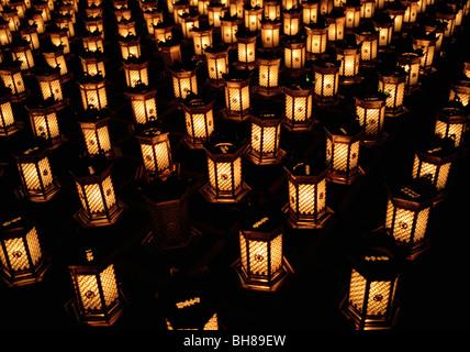 Illuminated lanterns arranged in rows, Miyajima, Japan - Stock Image