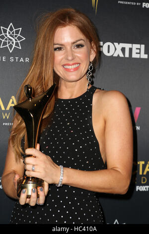 Sydney, Australia. 7 December 2016. Pictured: Actress Isla Fisher poses with her award in the media room. Celebrities, - Stock Image