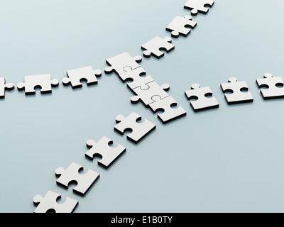 Jigsaw pieces bridging the gap - Stock Image