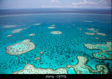 Aerial views of the spectacular Great Barrier Reef near the Whitsunday Islands in Queensland, Australia. - Stock Image