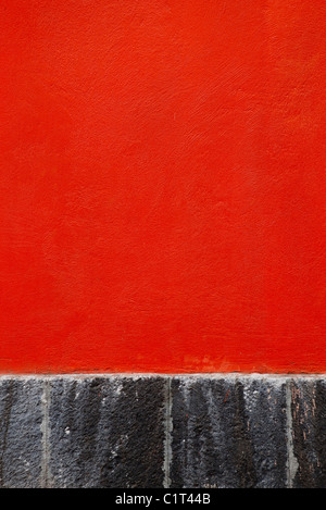 Red stucco wall, close-up - Stock Image