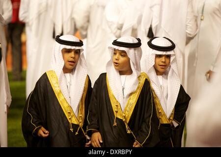 Meydan Racecourse, Dubai, UAE. 29th March, 2014. Three young princes greet the riders as they enter the parade ring during the Dubai World Cup Credit:  Tom Morgan/Alamy Live News - Stock Image